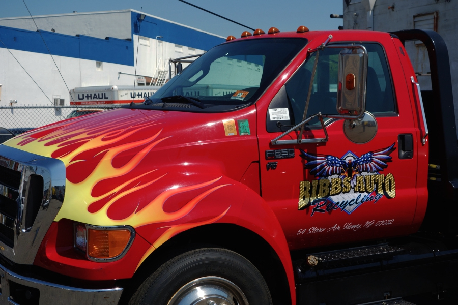 Towing truck with custom tribal flames logo with gold for Big truck lettering