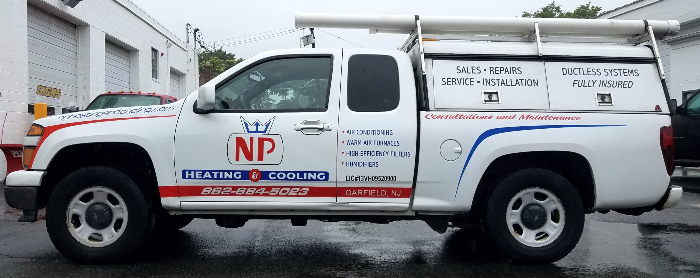 NP Heating and Cooling pick up truck lettering